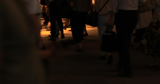 A night cityscape of walking people at the business town in Tokyo GIF