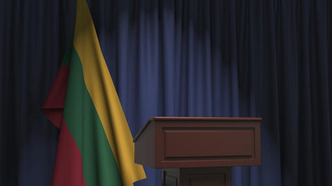 National flag of Lithuania and speaker podium tribune. Political event or Live Action