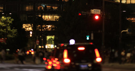 A night cityscape of walking people at the business town in Tokyo long shot ビデオ