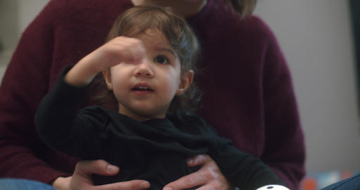 Cute 1-year old toddler girl at home GIF