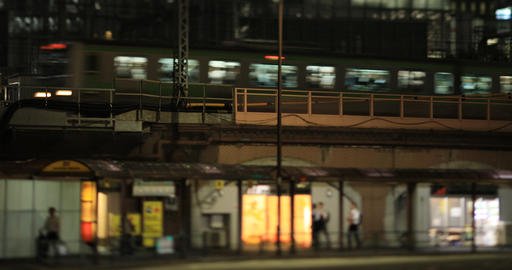 A night cityscape of train passing on the railway at the business town in Tokyo GIF