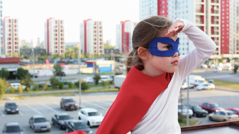 Superhero kid against urban background ビデオ
