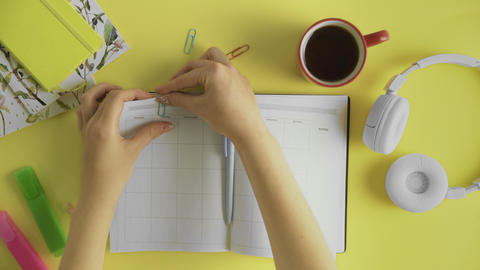 Writing FITNESS on a monthly planner to remember this date GIF