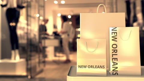 Shopping bags with NEW ORLEANS text against blurred store. American retail Footage