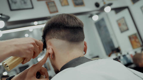 Close-Up Portrait Of Attractive Young Man Getting Trendy Haircut ビデオ