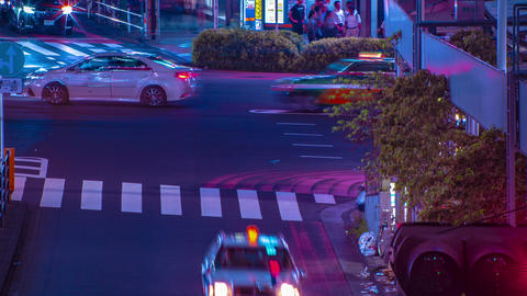 A night timelapse of the neon street in Shinjuku Tokyo high angle long shot zoom Footage