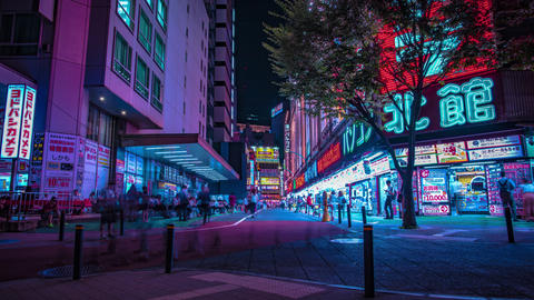 A night timelapse of the neon street at the downtown in Shinjuku Tokyo wide shot Footage