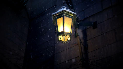 Lamp with snow falling in winter night Live Action