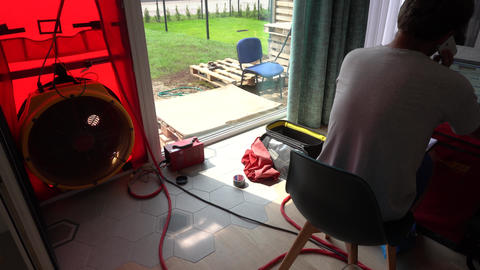 Skilled specialist man do door blower test. Certificating energy efficient house Live Action
