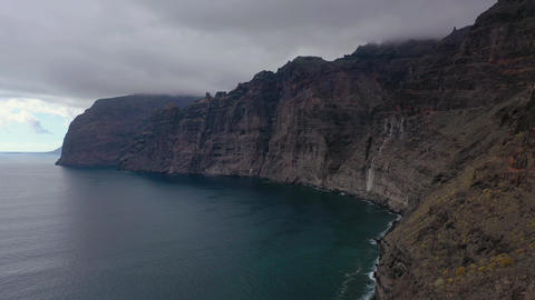 Aerial view of Los Gigantes Cliffs on Tenerife overcast, Canary Islands, Spain Footage