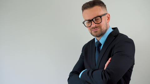 Portrait of a bearded formally dressed bearded man with glasses straightens his Footage