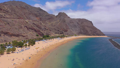 View from the height of the golden sand, palm trees, sun... Stock Video Footage