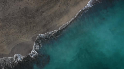 Top view of the desert black beach on the Atlantic Ocean. Coast of the island of Footage