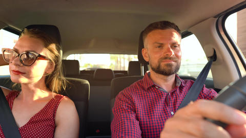 Beautiful couple rides in a car and admires the surrounding views Footage