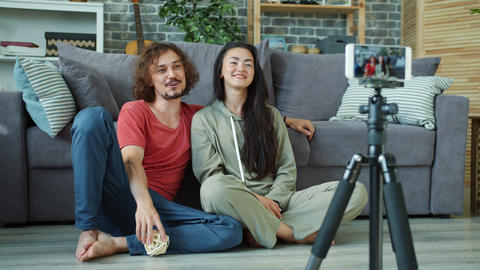 Man and woman recording video for internet vlog using... Stock Video Footage