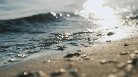 The rays of the sun, sea waves on the shore close-up.... Stock Video Footage