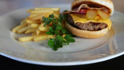 Unhealthy food.Dolly shot of burger and french fries on a white plate.Energy Archivo