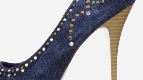 Close-up. Stylish women's high-heeled shoes encrusted with rhinestones. Panorama Footage