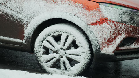 Snow covered dirty car in the parking lot. Snowy car on winter time after Live Action