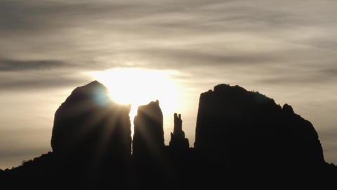 Mystical Sun and Clouds Behind Sedona Rock Formations Slow Pan Time Lapse Live Action