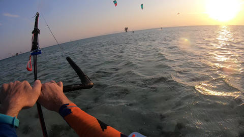 POV footage of kitesurfer gliding in the sea, looking at the horizon, sunset, 4k Live Action