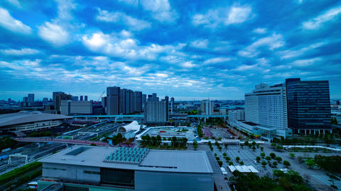 A dusk timelapse of the cityscape at the urban street in Ariake Tokyo wide shot Live Action
