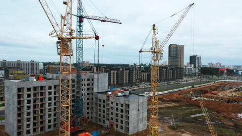 Drone fly above construction crane, development process of high rise block of Live Action