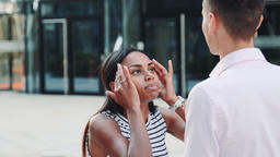 Close-up of mixed-race girl quarreling with her boyfriend outdoors and then Footage