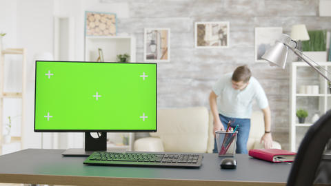 Cozy bright living room with an isolated green screen monitor on the table Footage