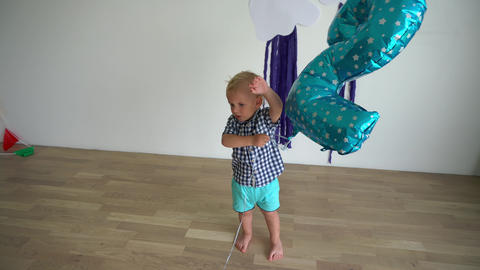Two years old boy play with balloon. Gimbal movement Live Action