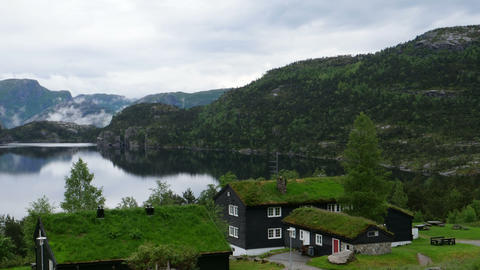Norvegian Houses with Green Roof in a Lake. Natural Landscape in 4K Time Lapse Footage