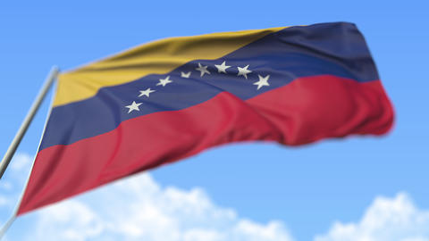 Flying national flag of Venezuela, low angle view. Loopable realistic slow Live Action