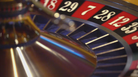 Roulette wheel - close up shot - ball on 13 black Live Action