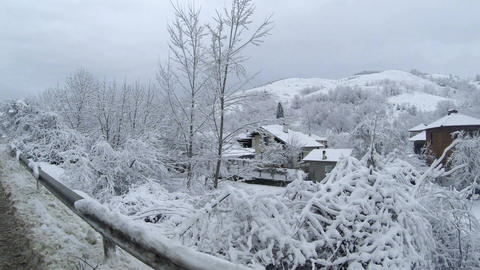 Snow covered village in the mountains during winter time Footage