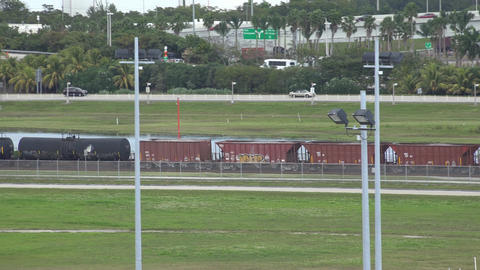 Cargo Train near Highway Live Action