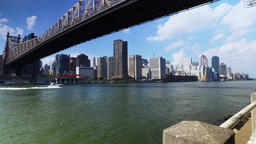 Queensboro Bridge with Boat on East River Establishing Shot Footage