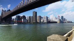 Queensboro Bridge with Boat on East River Establishing Shot Footage