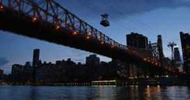 An evening establishing shot of the Ed Koch Queensboro Bridge between Manhattan  Footage