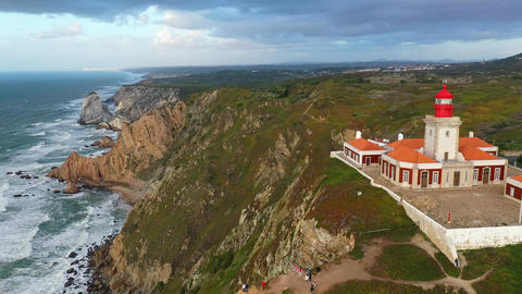 Famous Cabo da Roca lighthouse at the Atlantic Ocean in Portugal Footage