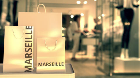 Paper bags with Marseille text. Shopping in France related 3D animation GIF
