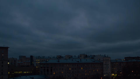 Dark cloudy sky over the city. Sky background Live Action