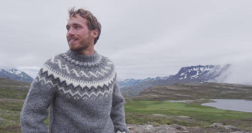 Portrait of man in Icelandic sweater outdoor smiling walking in nature Iceland Live Action