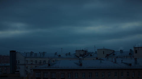 Dark cloudy sky over city buildings. Sky background Live Action