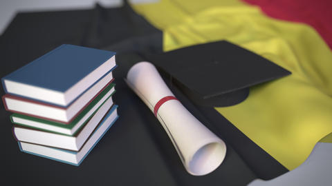 Graduation cap, books and diploma on the Belgian flag. Higher education in Footage