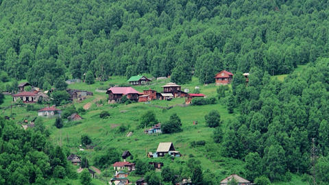 The mountain village Russia. View of the small village across the River Live Action
