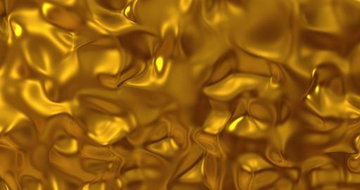 Golden wave liquid background. Glamour satin lava texture 3D rendering loop 4k Animation