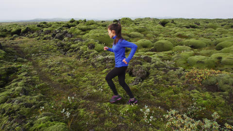 Young woman runner training running - Fitness woman jogging outdoor Live Action