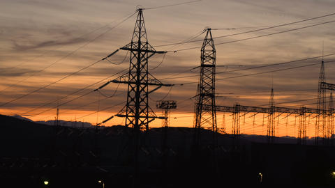 Silhouettes Of High voltage electric tower on sunset time and sunset sky with Live Action