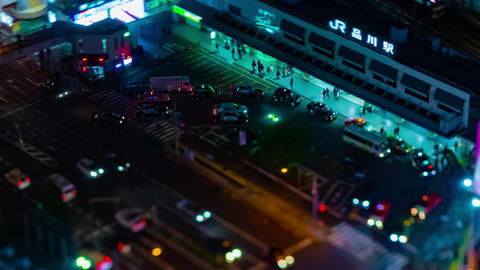 A night timelapse of panoramic view at the urban city in Tokyo high angle tilt Live Action