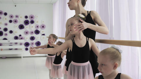 Girls dancers in ballet school learns to dance. Graceful girls in black and pink Live Action